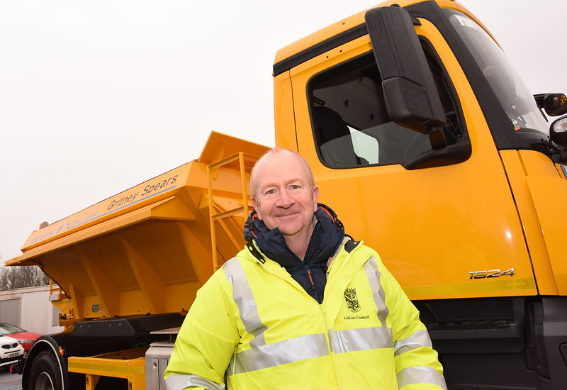 Councillor Paul Garner in front of grit truck